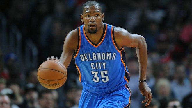 Kevin Durant moves the ball up court  against Los Angeles Clippers during the first half at Staples Center.