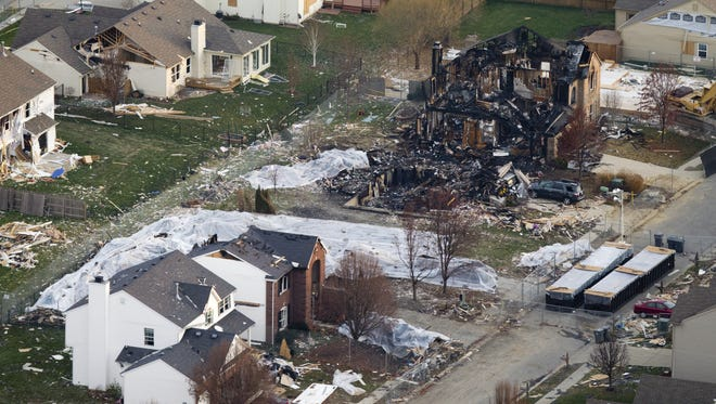 The scene of homes being torn down by demolition crews on the scene of a November 10 blast that killed two people, in the Richmond Hill neighborhood of southern Indianapolis, Tuesday, November 27, 2012.