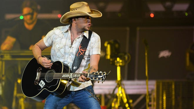 Country singer Jason Aldean performs at the MGM Grand Garden Arena on his 2013 Night Train Tour Sunday in Las Vegas, Nevada.