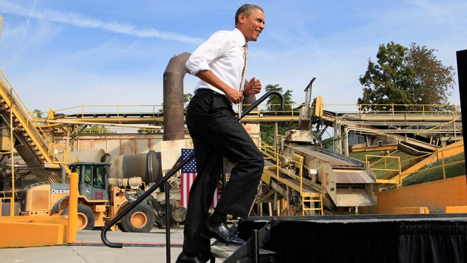 President Obama arrives to speak during a visit to M. Luis Construction, a construction company in Rockville, Md.