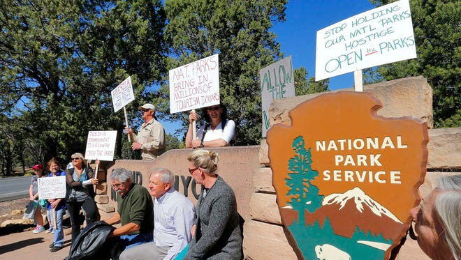 Government shutdown protesters gather at the Grand Canyon National Park entrance in Tuscon, Ariz.