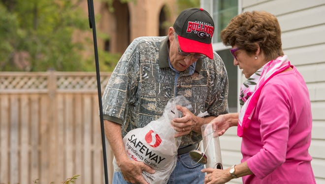 Carol Blackwell prepares to fill a bird feeder with her husband, Bob Blackwell, during her daily visit to see him at the Great Falls Assisted Living facility in Herndon, Va. on Sept. 25, 2012.