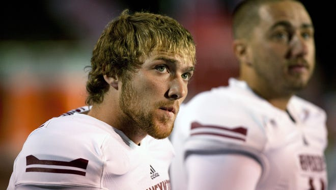 In this Oct. 5, 2013, file photo, New Mexico State place kicker Maxwell Johnson watches the scoreboard at the end of a 66-17 loss to New Mexico in an NCAA college football game in Albuquerque, N.M. New Mexico State has the nation's longest active streak of losing seasons (11 in a row) and the worst record of any FBS school over the last decade (28-94). Since 1968, they have a grand total of four winning seasons.