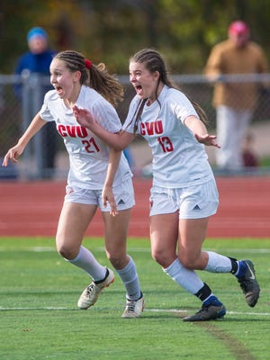 Champlain Valley Union's Charlotte Hill, right, celebrates her goal against Burr & Burton with Josie Pecor during the girls Division 1 high school state championships in Burlington on Saturday, November 4, 2017.