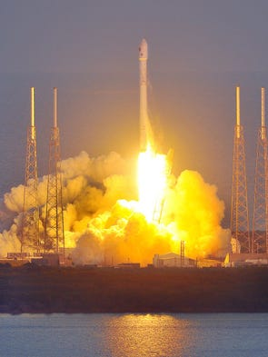 A SpaceX Falcon 9 rocket blasts off from Cape Canaveral