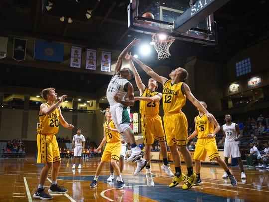 White Station (Tenn.) Allen Hatchett attacks the basket against Mitchell.