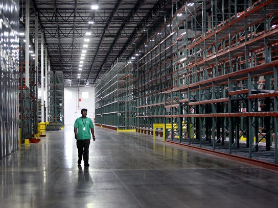 An employee walks through Volvo's truck parts distribution center near Memphis at Byhalia, Miss.