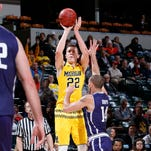 Duncan Robinson of the Michigan Wolverines shoots against the Northwestern Wildcats in the Big Ten tournament Thursday, March 10, 2016, at Bankers Life Fieldhouse in Indianapolis. Michigan won, 72-70, in overtime.
