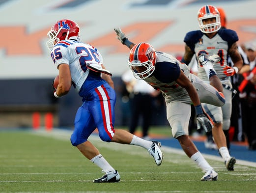 Louisiana Tech Bulldogs running back Blake Martin breaks a tackle and runs in for a touchdown against the UTEP Miners at Sun Bowl Stadium.