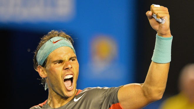 Spain's Rafael Nadal celebrates his victory against Switzerland's Roger Federer during their men's singles semi-final match on day 12 of the 2014 Australian Open tennis tournament in Melbourne on January 24, 2014.