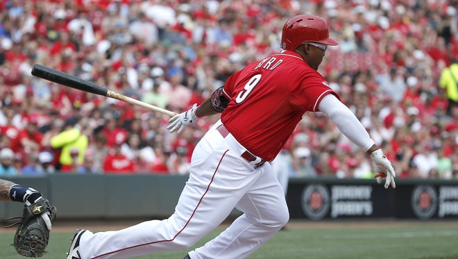 Reds left fielder Marlon Byrd singles during Saturday's game between the Reds and the Nationals.