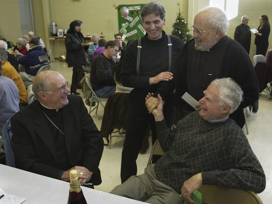 In 2007, from left, From left, Bishop John Leibrecht, Father Frank Iacona, Father Denis Dougherty and Tom Walmsley exchange greetings.
