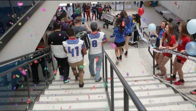 Students at Las Cruces High School line the stairs as a film crew shoots a lip dub video on Friday, Oct. 23. The video received more than 10,000 views in just over 24 hours.