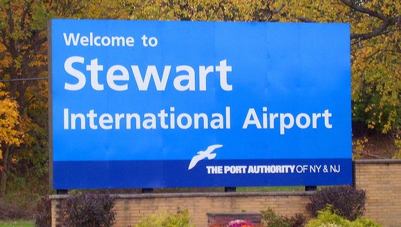 A sign welcomes travelers to the Stewart International