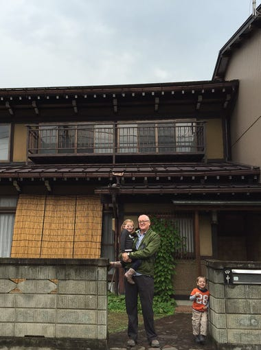 Derek, Harper and Walker Hughey outside the family's rented home in Hida, Japan.