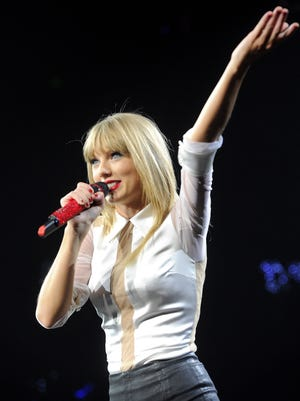 Taylor Swift performs at Bridgestone Arena on Thursday Sept. 19, 2013, in Nashville, Tenn.