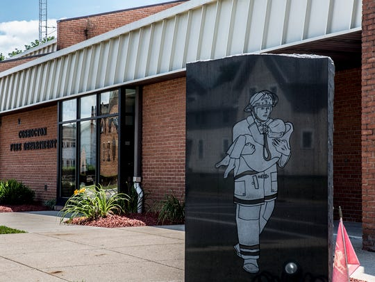 A memorial dedicated to Wilmer Hale stands out front of the building named for him. The fire captain with the Coshocton Fire Department died in 1975 when a wall fell on him while fighting a fire at Buckeye Fabric.