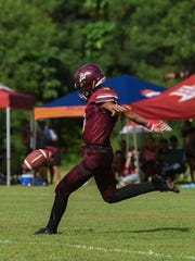 Father Duenas friar Xavier Naputi kicks the ball off against the George Washington Geckos during their Interscholastic Football League game at the University of Guam Field on Oct. 7, 2017.