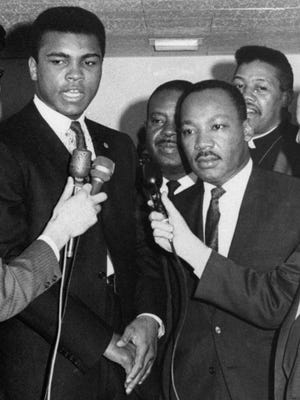 Muhammad Ali, left, and Dr. Martin Luther King speak with reporters in Louisville, Ky., in 1967.