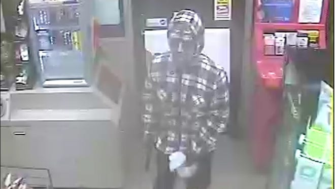 Surveillance photo of a man police are looking for who robbed a gas station in Lewes, Delaware.
