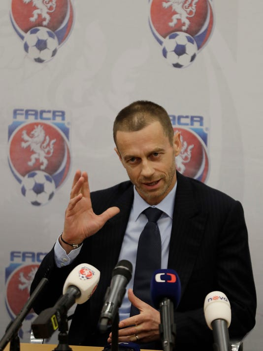 UEFA president Aleksander Ceferin addresses media at a news conference  in Prague, Czech Republic, Tuesday, March 21, 2017. (AP Photo/Petr David Josek)