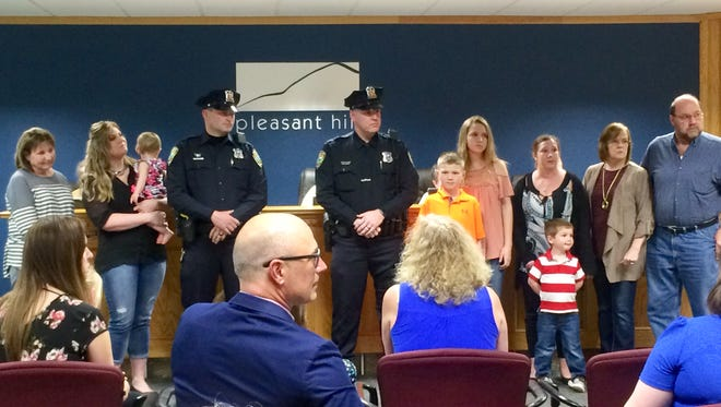 Pleasant Hill Police Officers Jeremy Bassett and Jason Burke and their families were invited to the Pleasant Hill City Council meeting April 24. The two officers received the department's meritorious service award for their bravery during a March 17 apartment fire.