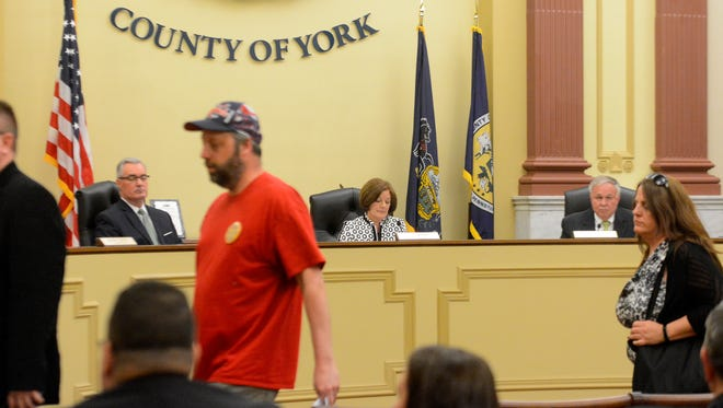 Attendees walk out of the York County Commissioners meeting after the commissioners voted to sell the Pleasant Acres Nursing Home, Wednesday, May 2, 2018. John A. Pavoncello photo