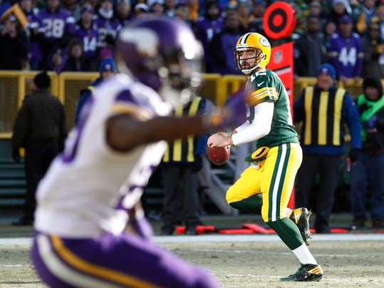 Green Bay Packers' Aaron Rodgers scrambles during the first half of an NFL football game against the Minnesota Vikings Saturday, Dec. 24, 2016, in Green Bay, Wis. (AP Photo/Matt Ludtke)