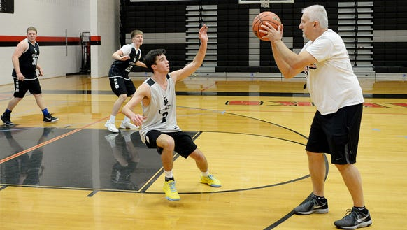 North Buncombe basketball coach Chuck Robinson runs