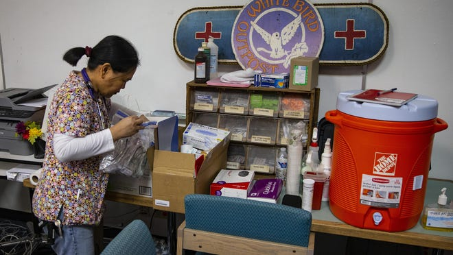 White Bird Clinic medical assistant coordinator Rose Brumley checks supplies at a clinic set up at the Lindholm Center across from Camp 99, a temporary camp set up earlier this year for people without a place to live last fall.