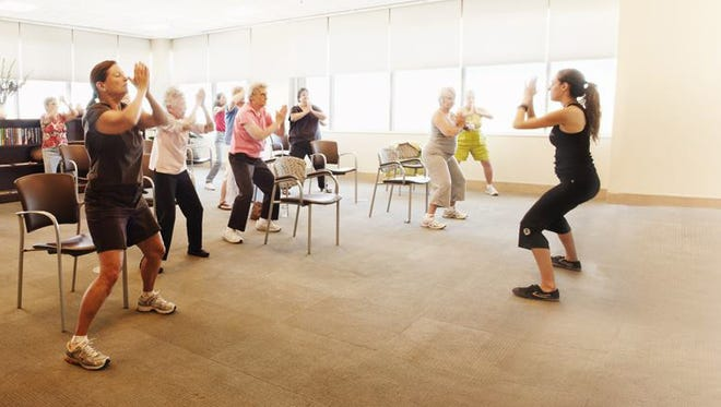 Seniors enjoy complimentary yoga at the Lifeprint Community Center, one activity offered at the Arizona Health and Fitness Expo.
