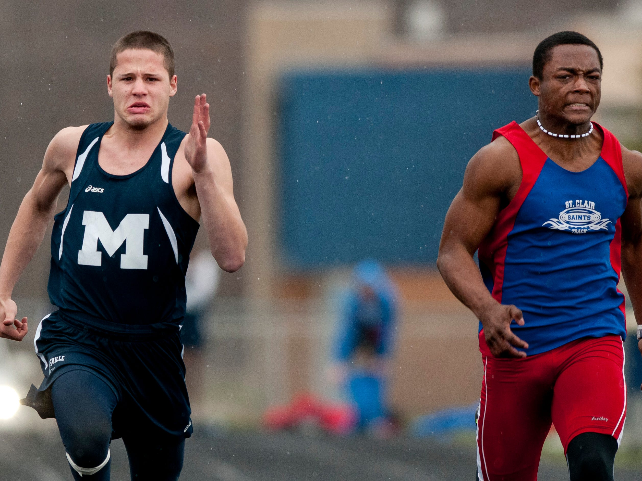 Marysville junior Seth Zeller and St. Clair sophomore Cameron Williams compete in the 100-meter dash during a track meet Thursday, April 30, 2015 at Marysville High School.