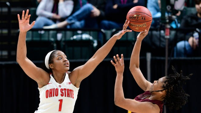 Ohio State Buckeyes forward Stephanie Mavunga (1) blocks a shot from Minnesota Golden Gophers guard Gadiva Hubbard (34) in the second period during the fourth round of Big Ten Conference Tournament at Bankers Life Fieldhouse. Ohio State defeated Minnesota 90 to 88.