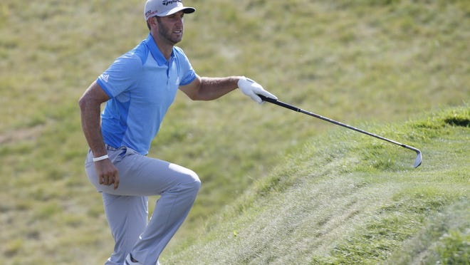 Opening-round leader Dustin Johnson's Jekyll-and-Hyde play left him looking up on the leaderboard Friday as the second round of the PGA Championship was suspended by severe weather.