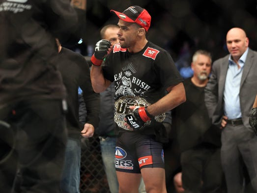 Renan Barao (red gloves) celebrates after beating Urijah Faber (not pictured) during UFC 169 at Prudential Center.