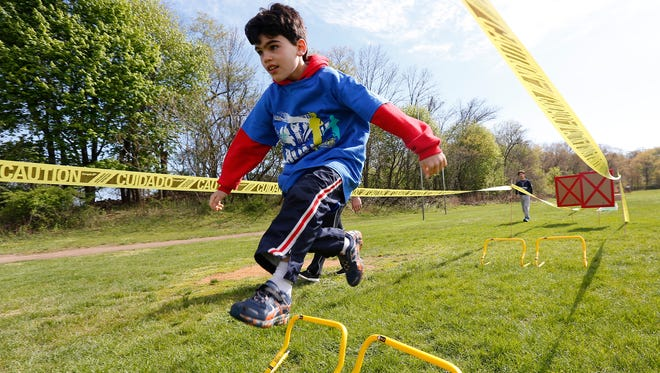 """Cody Ellis, 8, from Thiells runs an obsticle course at the second annual """"Sports Day for Charity"""" event at North Rockland High School in Thiells on Saturday, April 30, 2016."""