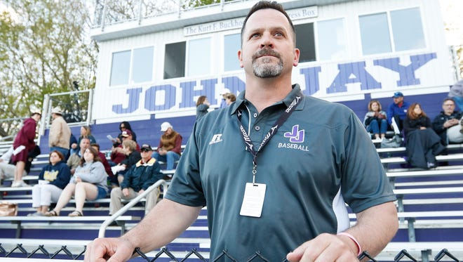 Chris McCarthy, athletic director for John Jay-Cross River High School, watches over the crowd at a boys lacrosse game on May 2, 2017.