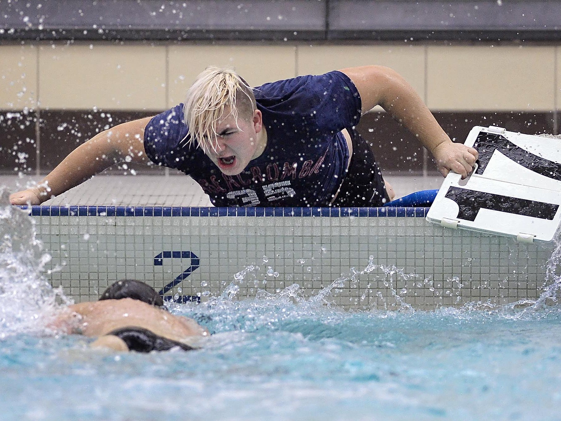 Brockport senior Sam Briggs, top, urges on Mike Spagnola as he makes a turn in the 500-yard freestyle.