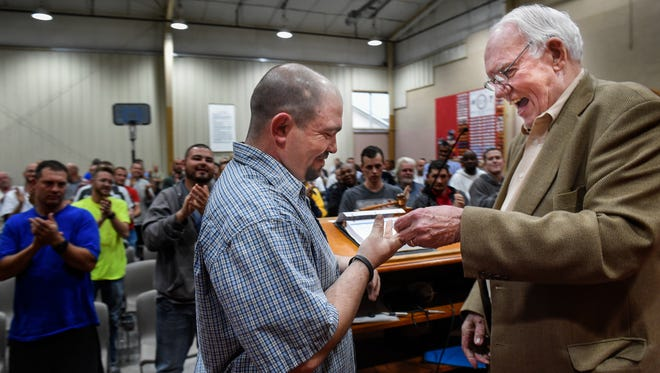 Matthew Lipps receives a standing ovation on Feb. 28, 2017, as Judge Seth Norman hands him a coin signifying that he graduated from Davidson County Drug Court.