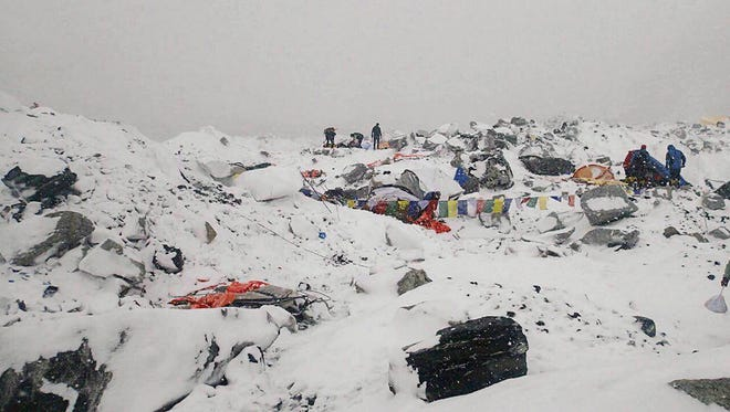 This photo provided by Azim Afif shows the scene after an avalanche triggered by a massive earthquake swept across Everest Base Camp in Nepal on April 25, 2015. Afif and his team of four others from the Universiti Teknologi Malaysia survived.