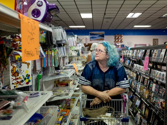 Carla Manska, of Burtchville Township, looks over items while walking down an isle Tuesday, September 20, 2016 at Bargain Barn in Port Huron. The business will close this Saturday after five years.