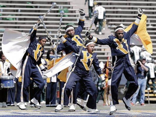 The Prairie View A&M University drum majors dance during their performance Saturday at the Historically Black Colleges and Universities marching band competition Saturday at Sun Bowl Stadium. Prairie View won the competition.