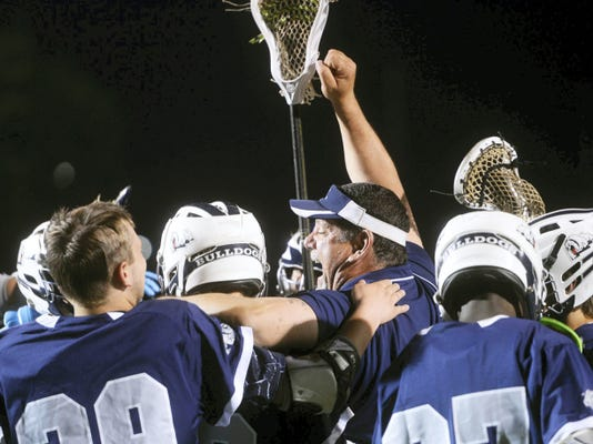 The West York boys' lacrosse team celebrates Thursday after beating Susquehannock, 16-7, to win the YAIAA tournament championship at Susquehannock. It was the Bulldogs' first YAIAA championship.