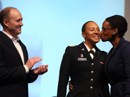 Second Lt. George Ann B. Voss (center) is pinned by her mentor, Scott Richardson, and mom, Elizabeth Voss, during the Texas A&M University-Corpus Christi Islander Army ROTC Commissioning Ceremony on Friday, Aug. 4, 2017. The ceremony marks the transition of graduating ROTC students from cadets to enlisted officers. Each of the five students will be commissioned a second lieutenant in the Army.