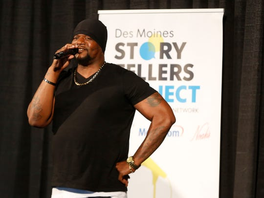 William Holmes, known by his stage name as Will Keeps, tells his story about growing up around urban violence Thursday, June 7, 2018, during the Des Moines Storytellers Project at Curate in Des Moines.