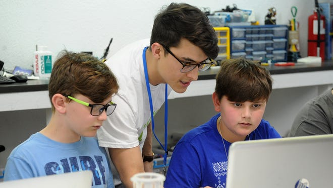 Michael Olaya, CEO and founder of Dexter Learning Company, teaches home-schooled students from around Texoma Saturday, March 10, 2018, about 3D printing and computer aided design inside the inside the Dexter learning space at 2301 Midwestern Parkway, Suite 101.