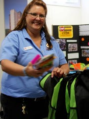Charyl Westbay, copy and print sales manager, at the South Burlington Staples, helps collect school supply donations for COTS.