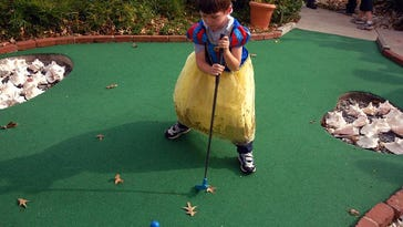 Zane Althouse 4, of New London Pa., plays miniature golf, at Shell We Golf & Shell Shop, as a part of the Sea Witch festival, in Rehoboth Beach.