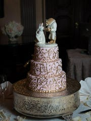 "The bride and groom chose a ""Beauty and the Beast"" cake topper because that's what they call each other."