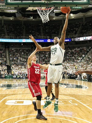 Michigan State's Nick Ward scores two of his 22 points last season against Ethan Happ and Wisconsin during the Spartans' 84-74 win at Breslin Center.